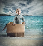 Child adventure in the sea Stock Photography