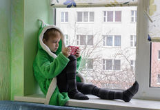 The child against the window. Royalty Free Stock Photo