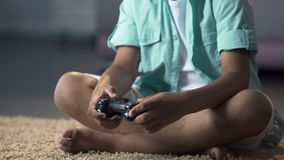Child aggressively pressing joystick buttons controlling character on console. Stock footage stock video