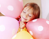 Child with air balloons Stock Images