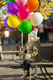 Child with air-balloons Stock Photography