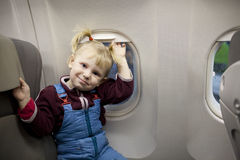 Child in the airplane Royalty Free Stock Photo