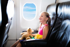 Child in airplane. Flight with kids. Family flying. Child in airplane. Kid in air plane sitting in window seat. Flight entertainment for kids. Traveling with royalty free stock images