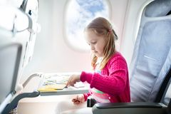 Child in airplane. Fly with family. Kids travel. Stock Image