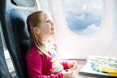 Child in airplane. Fly with family. Kids travel. Royalty Free Stock Photos