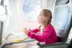 Child in airplane. Fly with family. Kids travel. Royalty Free Stock Photography