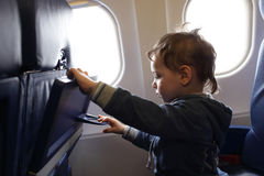 Child at airplane Royalty Free Stock Photos