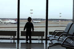 Child at airport stock image