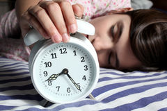 Child and alarm clock Stock Image