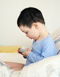Child with alarm clock Royalty Free Stock Images
