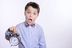 Child with alarm clock Stock Image