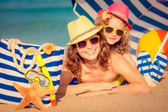 Child amd mother on the beach Royalty Free Stock Photo