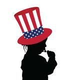 Child with american hat and lollipop Stock Images
