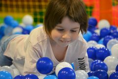 Little girl and soft balls stock photography