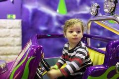 Child at amusement park Stock Photos