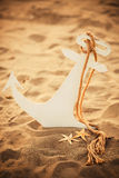 Child anchor on the sand. With attributes Stock Photos