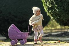 Free Child And Childhood Lifestyle. Girl Walking With Vintage Doll Stroller On Sunny Day Stock Photo - 119933390