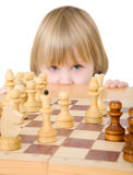 Child ang chess. Child and chess on a white background Royalty Free Stock Photography