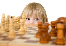 Child ang chess. On a white background Royalty Free Stock Photography