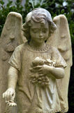 Child angel. Angel marker on childs grave from the 1870's Stock Photography