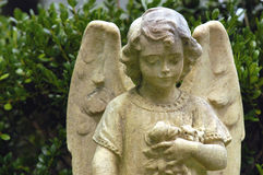 Child angel. Angel marker on childs grave from the 1870's Stock Image