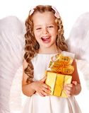 Child at angel costume holding gift box. Happy child at angel costume holding gift box Royalty Free Stock Photography
