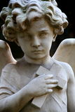 Child angel with cross statue. Tombstone with child angel holding a cross on cemetery in Rome Royalty Free Stock Images
