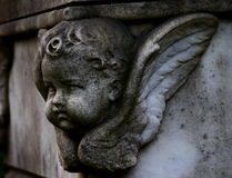 Child angel relief. Tombstone with baby angel on cemetery in Rome Royalty Free Stock Image