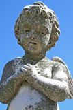 Child angel statue. Statue of child angel against blue sky Royalty Free Stock Photography