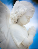 Child angel statue with a  sky background Royalty Free Stock Photos