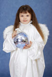 Child - angel with wings holding glass ball Stock Images