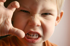 The child in anger. The little boy represents anger royalty free stock photography