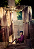 Child in Angkor Thom Ruins Stock Images