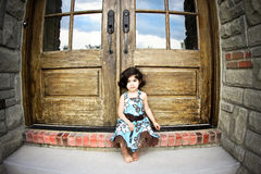 Child and antique door Stock Photo