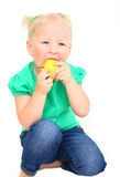 Child with an appetite for eating an apple Stock Photo