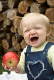 Child with the apple Royalty Free Stock Photo