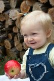 Child with the apple Stock Image