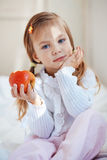 Child with apple Stock Photos