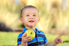 Child with Apple Royalty Free Stock Image