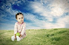 The child with an apple Royalty Free Stock Photo