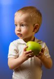 Child with apple Stock Photo