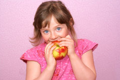 Child apple. The child with great pleasure eat an apple Stock Photo