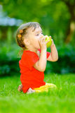 Child with apple. Royalty Free Stock Photo