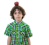 Child with apple in his head Royalty Free Stock Image