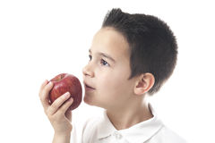 Child with apple looking upwards. Royalty Free Stock Photos