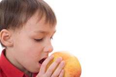 Child is the apple and opens her mouth Stock Photography