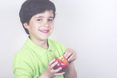 Child with apple. On a white background Stock Photography