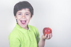 Child with apple. On a white background Stock Image