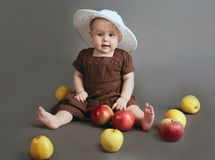 The child with apples on a gray background Royalty Free Stock Image