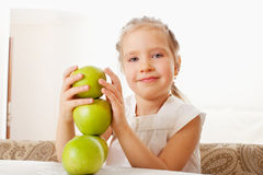 Child with apples at kitchen Stock Photo